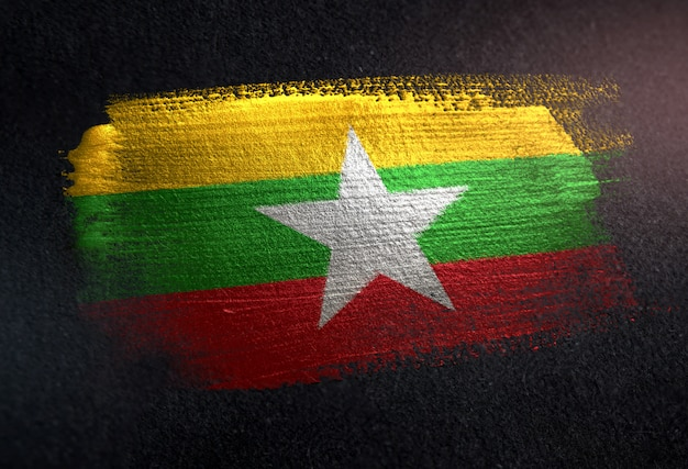 Myanmar flag made of metallic brush paint on grunge dark wall