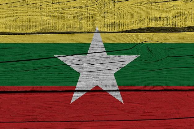 Myanmar flag painted on old wood plank