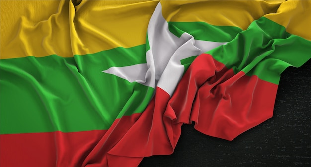 Myanmar flag wrinkled on dark background 3d render