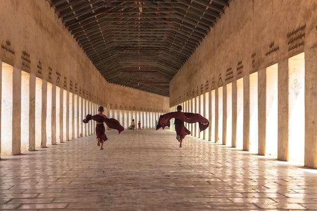 Myanmar novice monk walking together in ancient pagoda bagan mandalay .