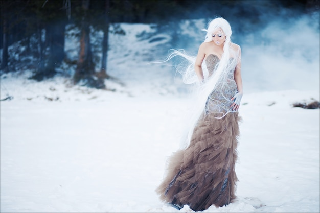 Mysterious art portrait of beautiful woman with white wig in fashionable long dress