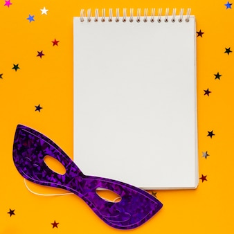 Mysterious carnival mask notepad copy space