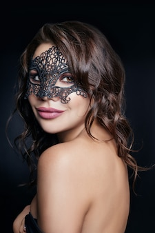 Mysterious girl in a black mask, masquerade