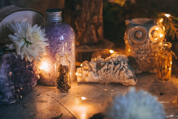 Mysterious halloween scene, witchcraft practicing, ritual candles.