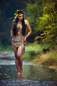 Mysterious image of a beautiful woman in woods