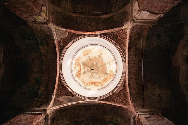 Mysterious mystical interior of an abandoned church, a dark gloomy building, the ruins of a church