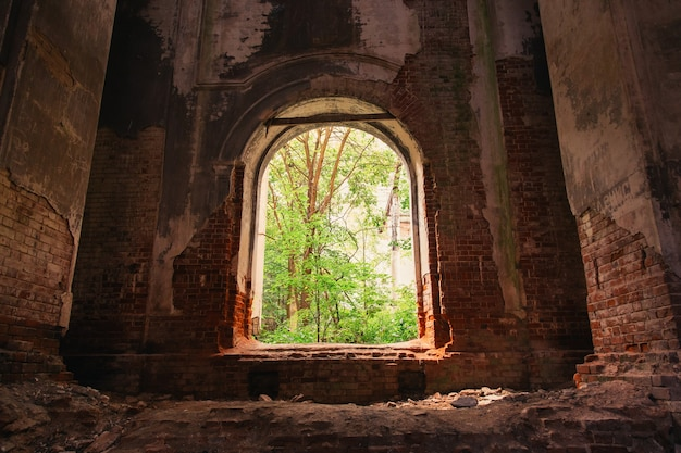 Mysterious mystical interior of an abandoned church, a dark gloomy building, the ruins of a church.