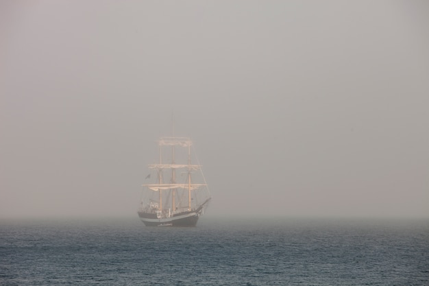 Mysterious sailing ship surrounded fog