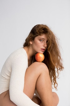Mysterious woman posing with red apple