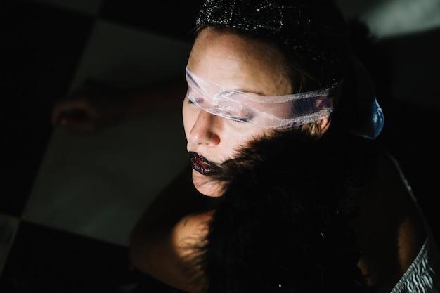 Mysterious woman in transparent eye bondage
