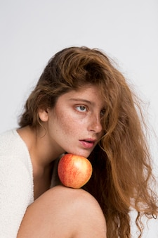 Mysterious woman with red apple