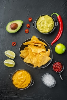 Nacho tortilla with cream sauce served with guacamole and cheese dip sauce