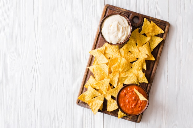 Nachos corn chips with spicy tomato and cheese sauces.