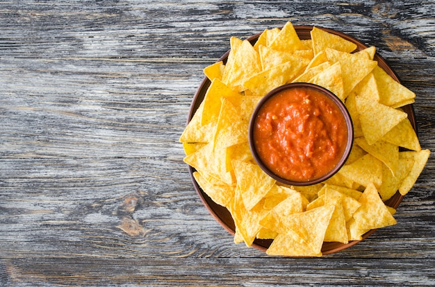 Nachos corn chips with spicy tomato sauce.