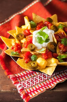 Nachos loaded with salsa, cheese and jalapeno
