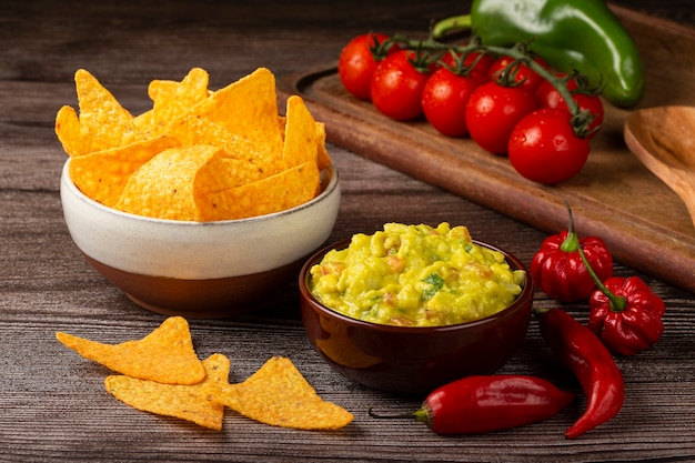 Nachos with guacamole on the table.