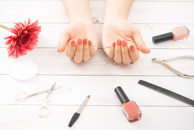 Nail care and manicure. beautiful female hands with nude nail polish