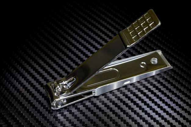 Nail clippers on black background.