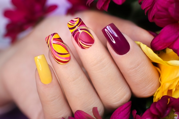 Nail design on shiny and matte nail polish with smooth curves.