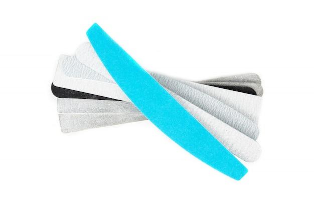 Пилочки для ногтей на белом фоне