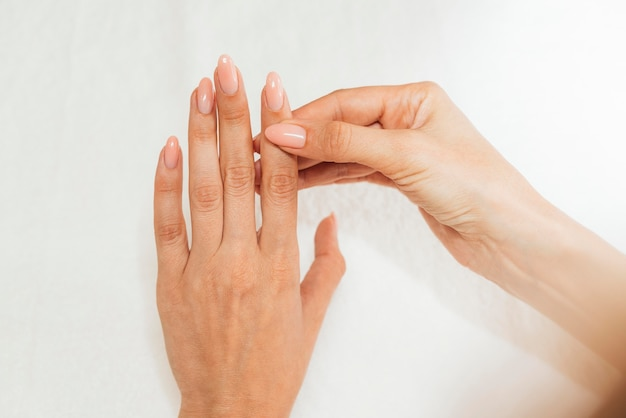 Nail hygiene and care feminine hands