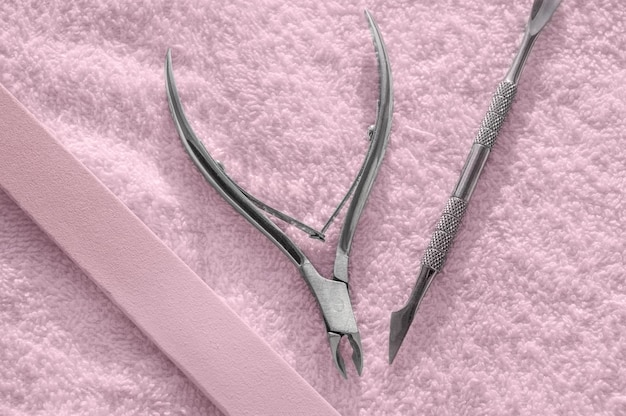 Nail kit tools on a pink towel, care and spa