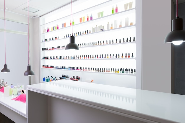 Nail and pedicure saloon modern with nail polish colorful in a row