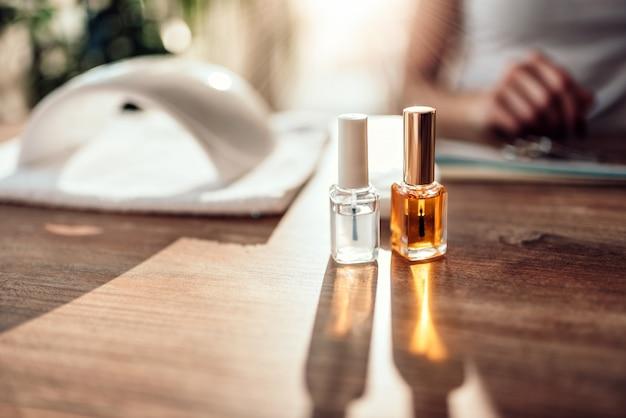 Nail polish bottles and uv lamp