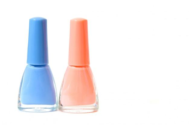 Nail polish bottles on white