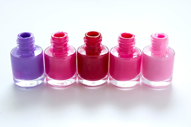 Nail polishbottles on white with copy space for text
