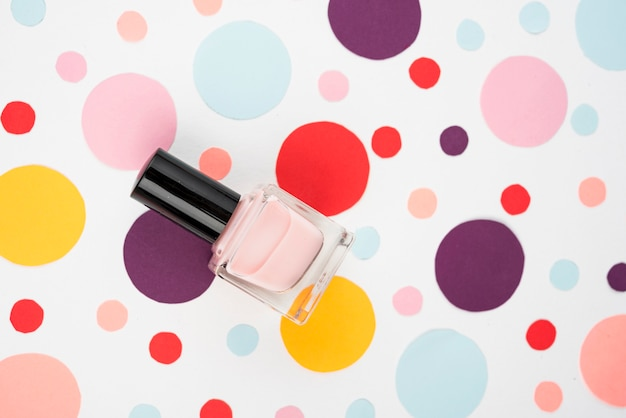 Nail varnish on colorful polka dots