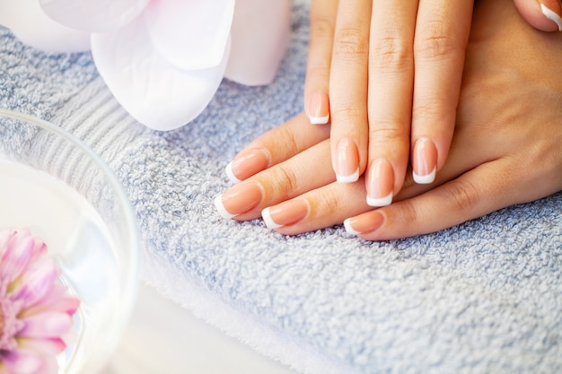 Nails care. beautiful woman's nails with french manicure