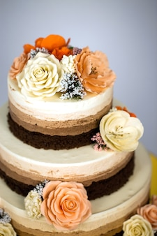 Naked cake. wedding rustic cake with flowers.
