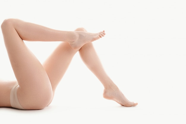 Naked female legs, skin body care concept