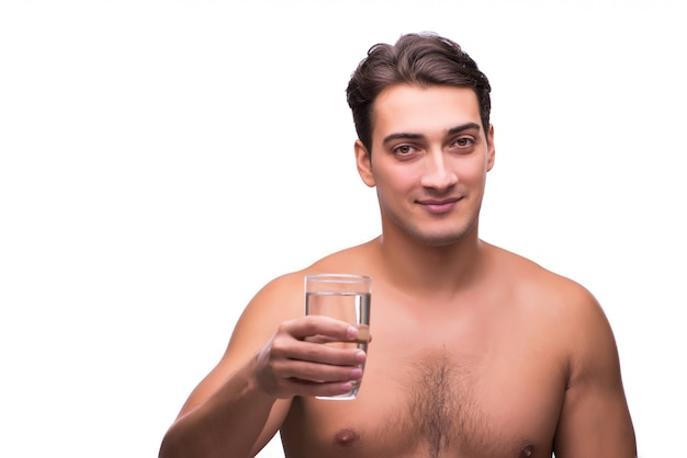Naked man drinking water isolated on white