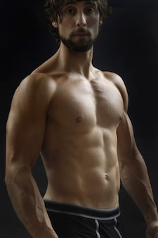 Naked man showing his body fitness