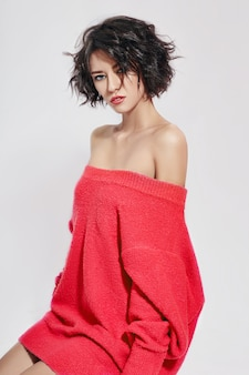 Naked sexy woman with short hair. girl in a red
