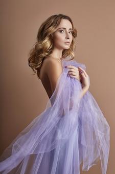 Naked woman art in lilac light transparent dress