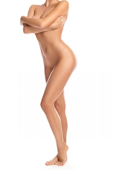 Naked woman covering her beautiful body with hands