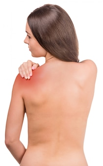 Naked woman with pain in shoulder