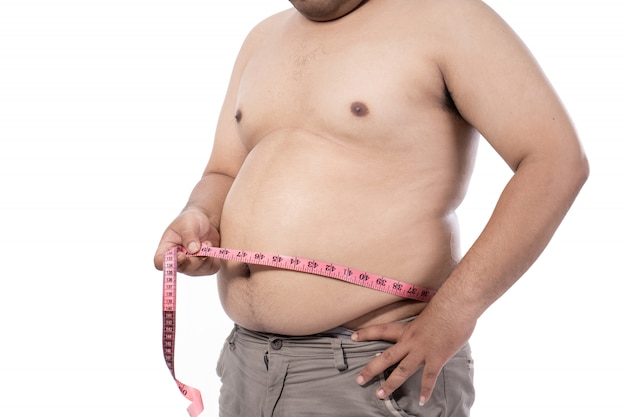 Naked young man measurement his stomach