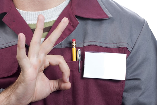 Name tag on uniform and ok sign