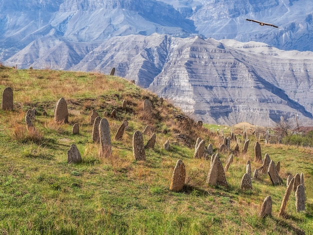 Nameless stone tombstones on the mountainside. tombstones made of stone. dagestan.