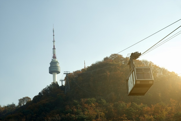 Namsan n seoul tower with the line of cable car in autumn at seoul, south korea.