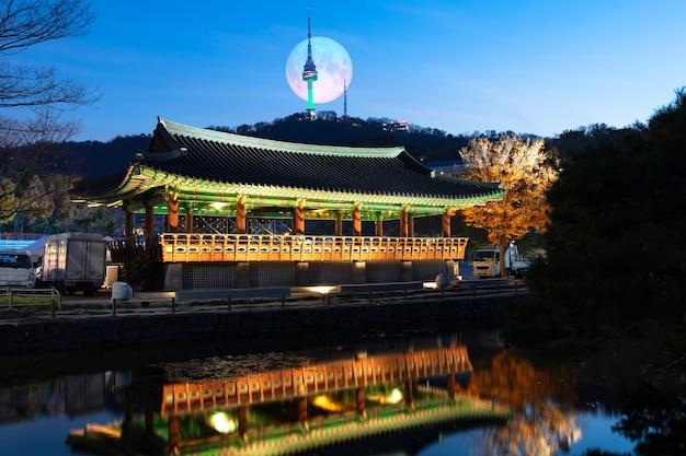 Namsangol hanok village in autumn with full moon seoul south korea