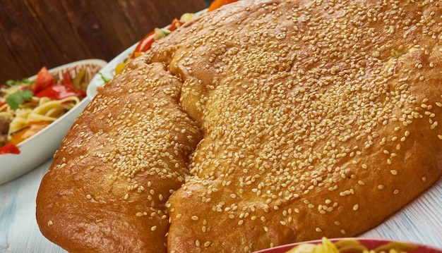 Nangbing -  traditional flatbread of the uyghur in western china.  uyghur cuisine,  asia traditional assorted dishes, top view
