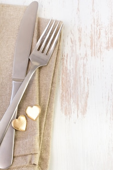 Napkin on white with fork and knife