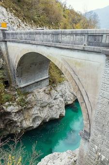 Napoleon bridge over emerald color soca river in slovenia