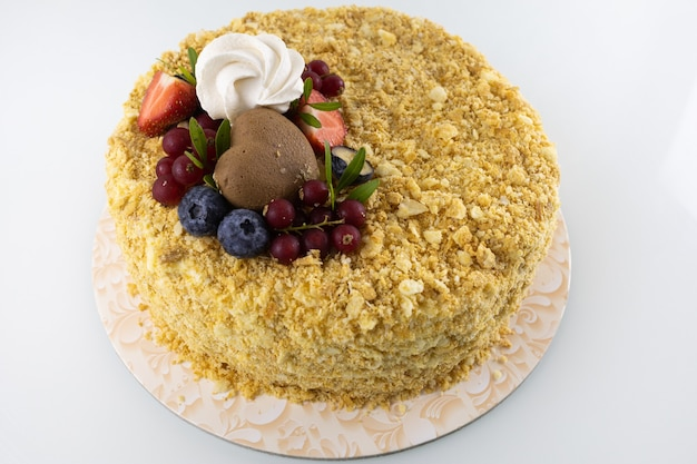 Napoleon cake with berries close-up on a case table