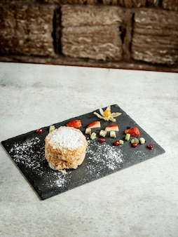 Napoleon dessert with strawberry pieces